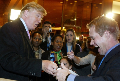 President Elect Donald Trump signs a book to a unidentified supporter in Nerw York.