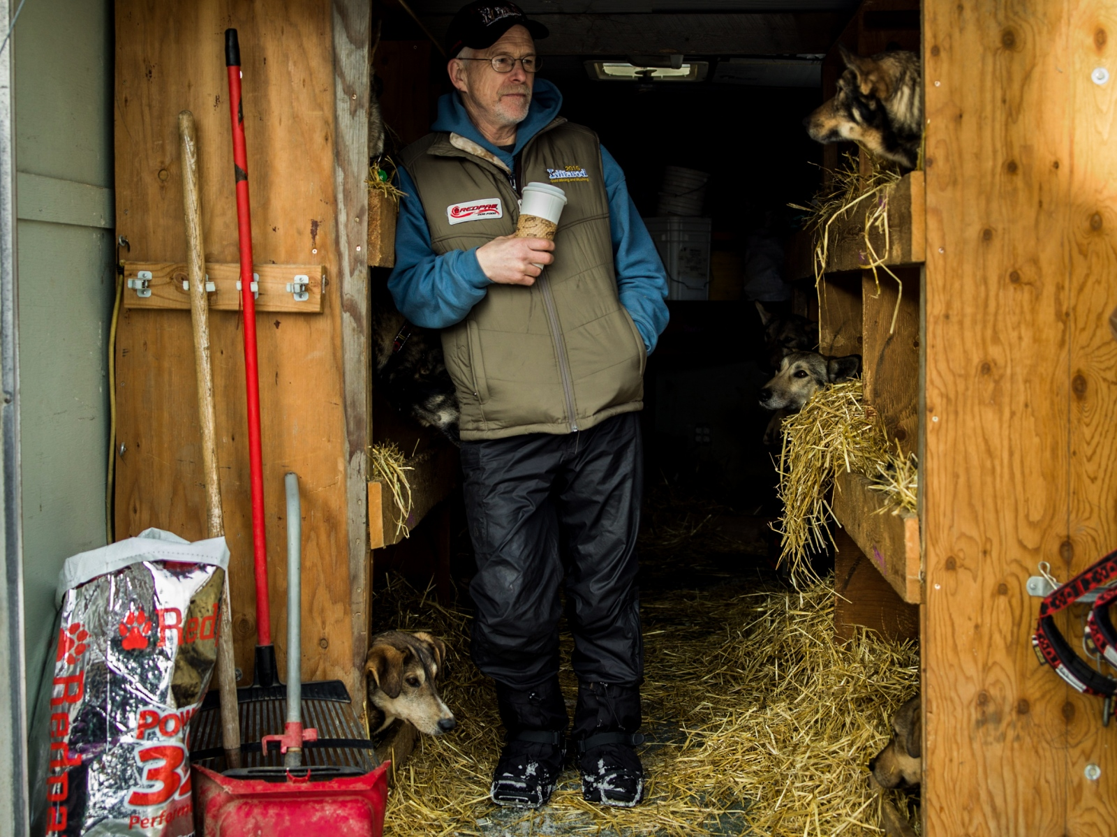 Four-time Iditarod champion Jeff King stands in his trailer with his dogs at the 2016 ceremonial start in downtown Anchorage on March 5, 2016.
