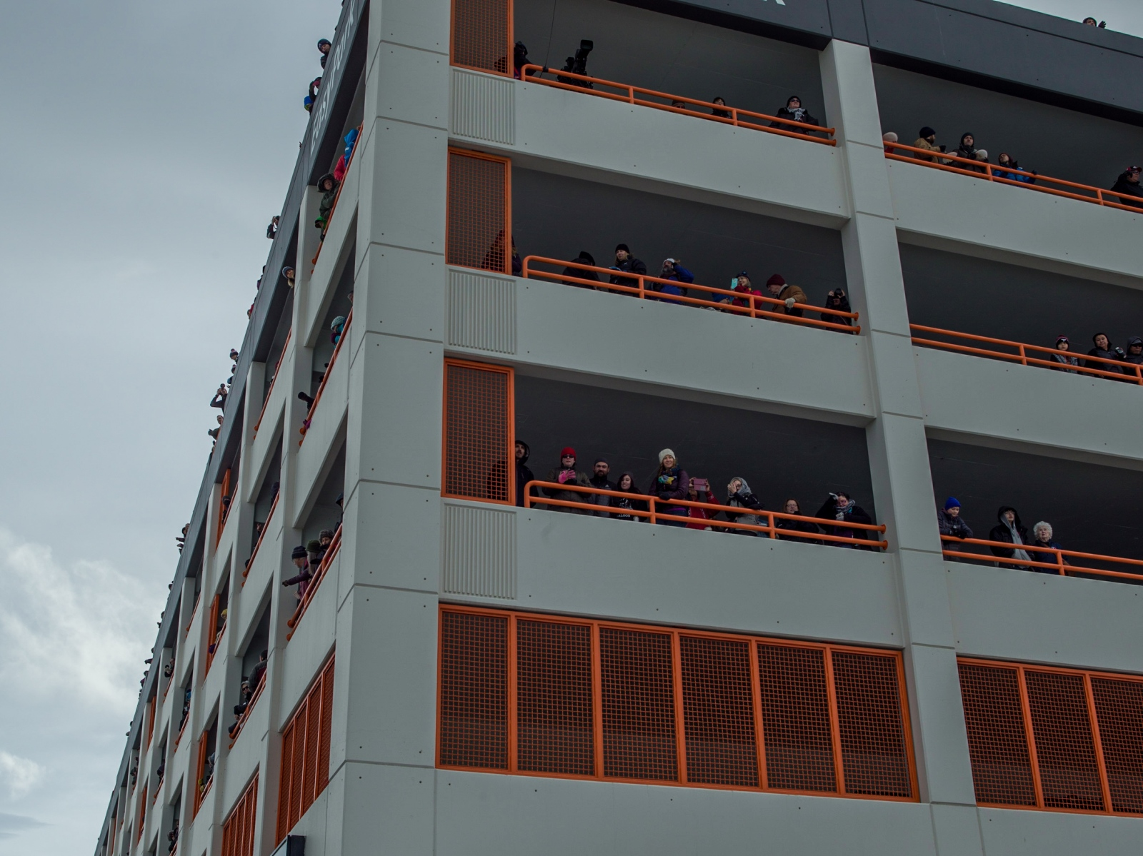 Spectators watch the ceremonial Iditarod start from a parking garage in downtown Anchorage on March 5, 2016.