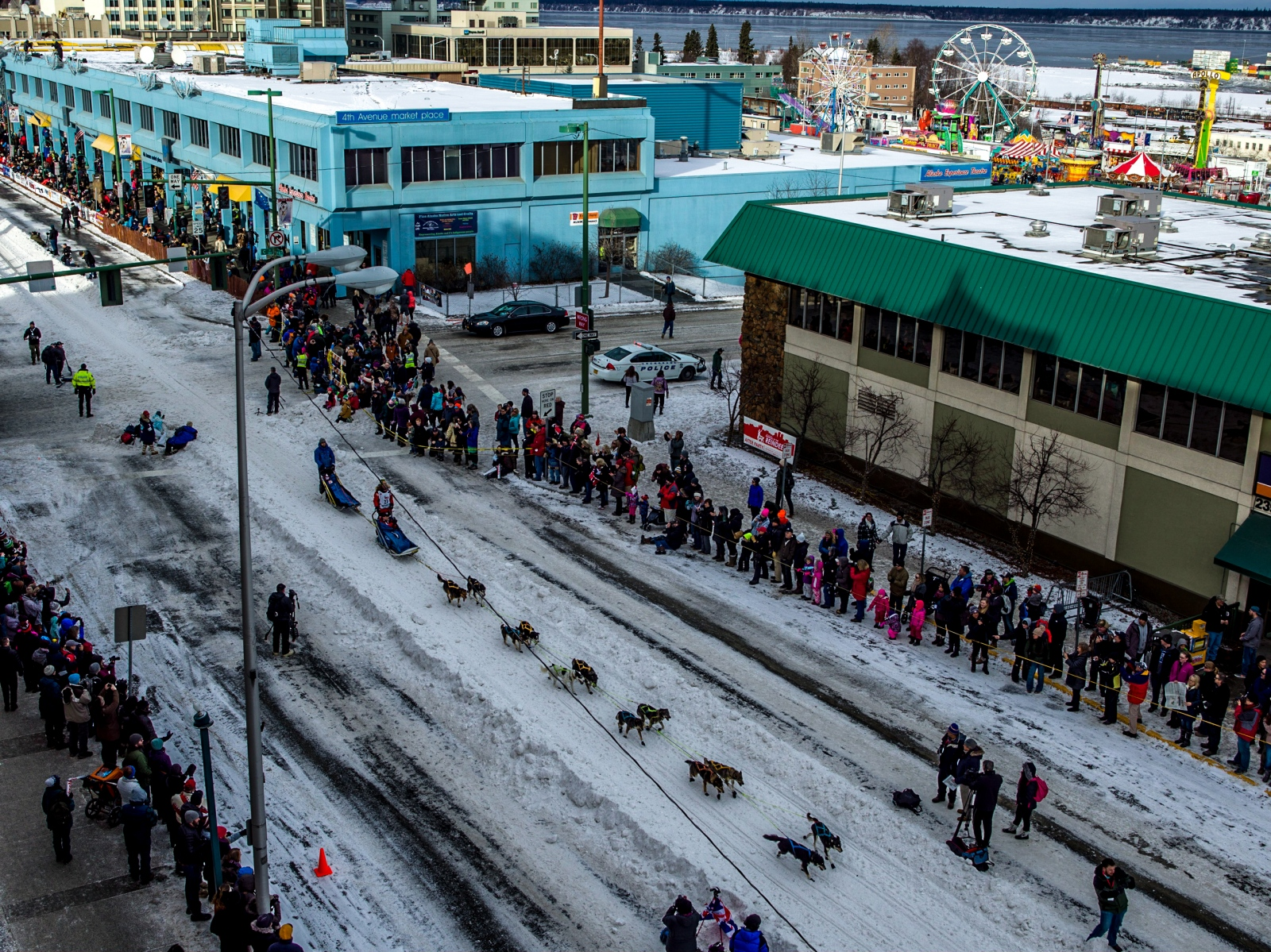 Sigrid Ekran mushes her team down 5th Avenue in Anchorage at the 2016 ceremonial Iditarod start on March 5, 2016. Due to lack of snow, snow was brought in by trucks and train days prior to the event, and the traditional 11-mile course was shortened to 3 miles.