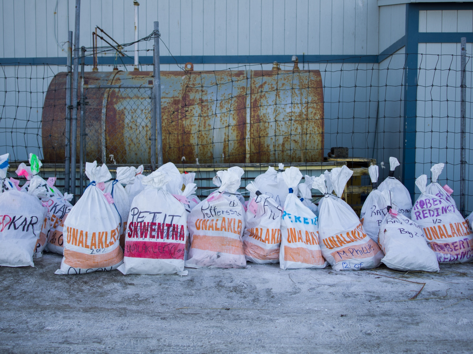 Bags of feed rest outside of Iditarod headquarters in Unalakeet, Alaska on March 12, 2016. Mushers were expected to arrive later that night.