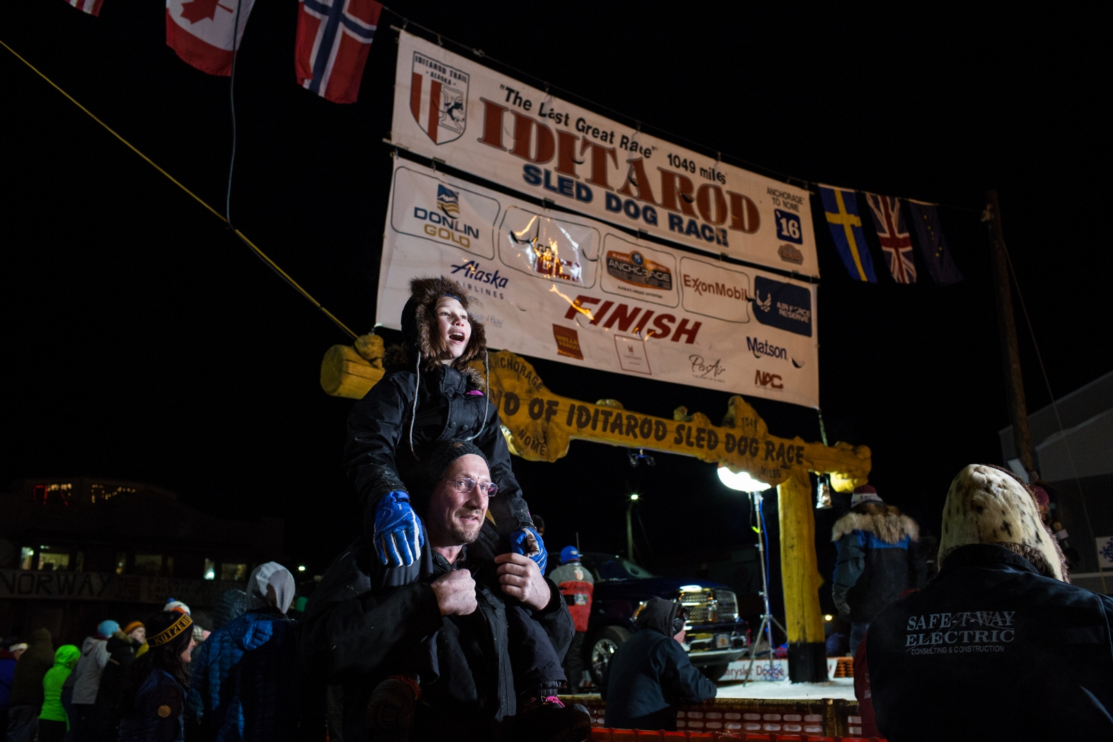 Crowds gather in Nome, Alaska at 2:00am on March 15, 2016 to await the arrival of the first musher.