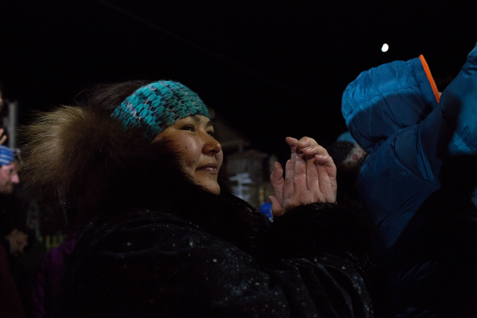 Crowds cheer for Iditarod XLIV champion Dallas Seavey in Nome, Alaska in the early morning hours of March 15, 2016.