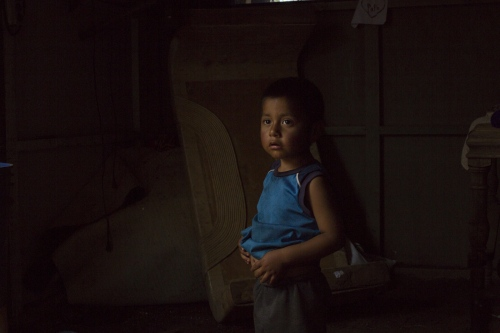 Brayan, 3, in his house constructed of particle board and plastic. His father makes 7 dollars a day picking strawberries sometimes working more than 12 hours. This is the only income for a family of 4.