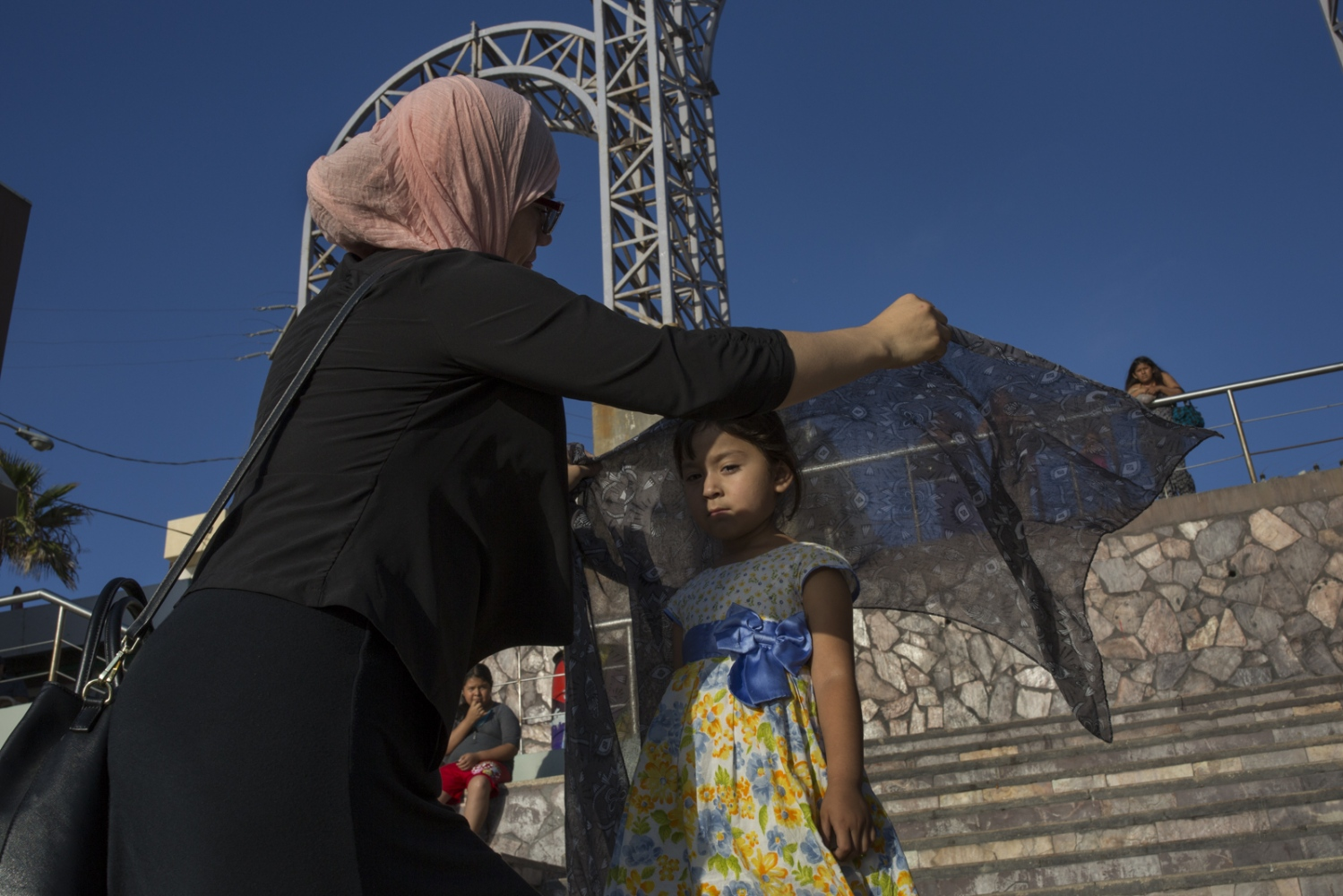 Mexican Muslim convert Ines Valdivia fixes her friends' daughter Michelle's hijab before heading to the mosque in Playas de Tijuana.
