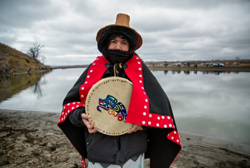 November 24, 2016 - Cannon Ball, North Dakota, United States: Christina Oliver-Schuckenbrock, of greater Seattle area, is a descendant of Emmett Oliver who in 1989 started the Canoe Journey Paddle to Quinault tradition. Canoe Journey is an event that takes place every year, where different native American coastal tribes travel by canoe from their reservations to the host reservation where they celebrate for one week sharing songs, stories, food, and gifts.