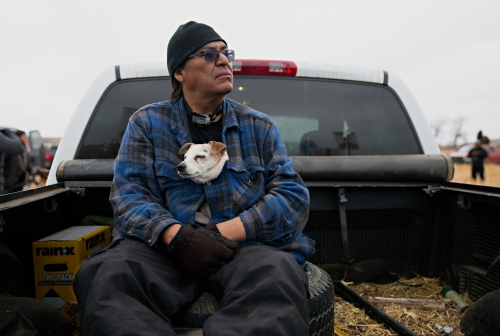 November 24, 2016 - Cannon Ball, North Dakota, United States: Michael Zephyr, of Standing Rock Sioux Reservation, has been at the camp for 13 weeks and will remain as long as it takes. His 10-year-old companion Sunny will be with him as well.