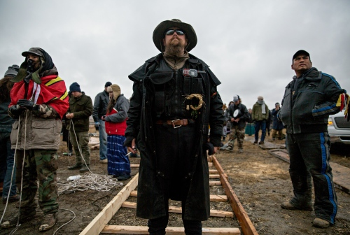 """November 24, 2016 - Cannon Ball, North Dakota, United States: Adoneus Bishop of Elgon Washington, has been in the Camp for 10 weeks and is member of the Oceti Sakowin Group. He says: """"I am not going anywhere."""" The Common Man's Society of the Oceti Sakowin Camp at Standing Rock, ND, is a group of men and women who Serve, Protect, And Tend to the well being of camp."""