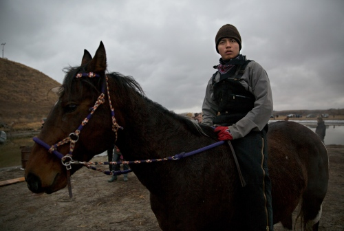 November 24, 2016 - Cannon Ball, North Dakota, United States: Kasey Thomson, of Cheyenne River Indian Reservation, South Dakota, rides Beauty during the Thanksgiving face-off with the law enforcement.