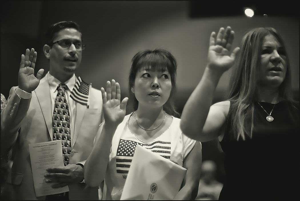 Naturalization ceremony, July 4, 2016. From left, Syrian, South Korean and Mexico natives taking oath. Arizona.