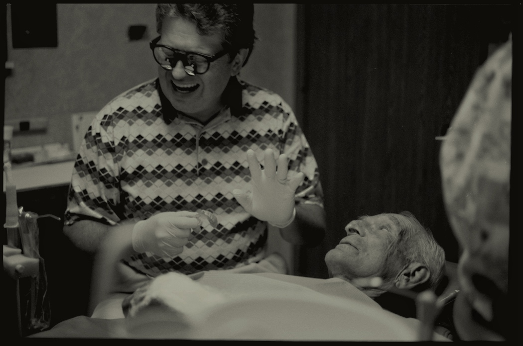 Dr. James Cuglewski, who had his first, and most every haircut during his adulthood done by James Patronite, shares a laugh in the examination room of his Ohio dentist practice. 2011.