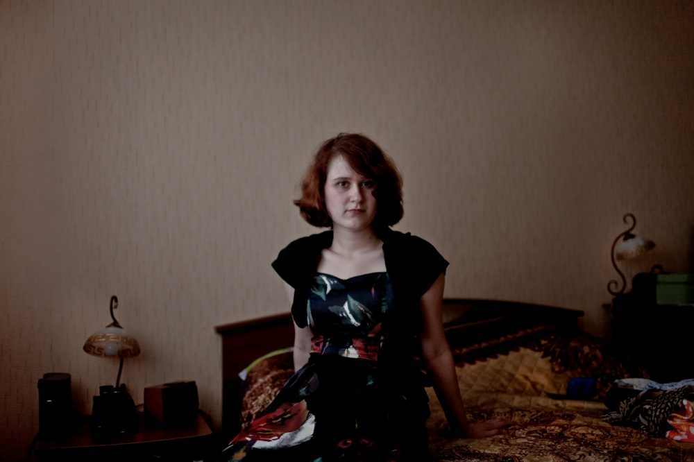 Maria Yurkina, fourth generation Russian German sits for a portrait at her home in Syktyvkar, Russia. Maria's grandmother feels Russian but speaks the German language. Her family was exiled to the Komi Republic in 1945.