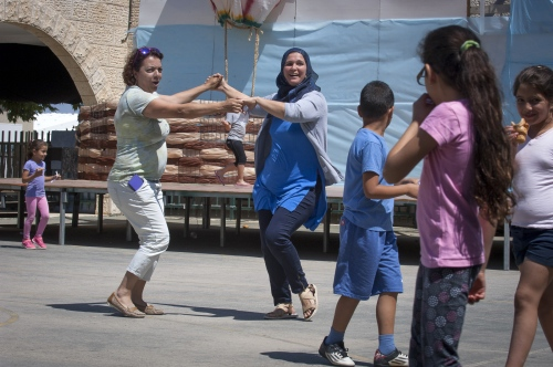 """Wadi Ara teachers Shuli Kelin and Amina Tamne get in the end of year spirit while dancing to Soul Controls song 'Choco, Choco, Cholate."""" A very popular number with the staff and pupils."""