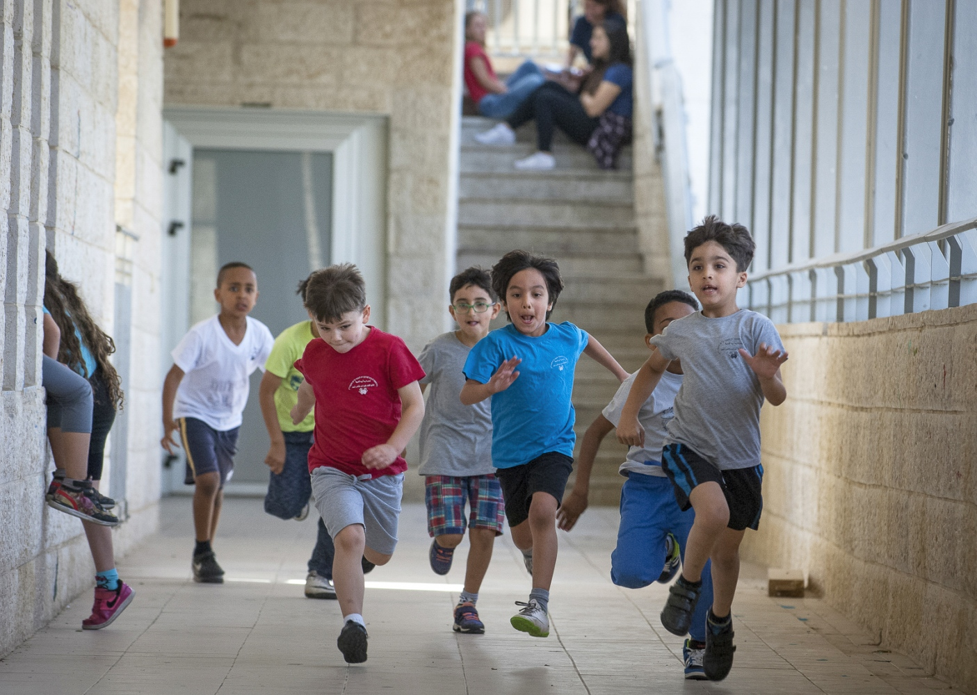 First Grade children playing happily together in the corridors of The Max Rayne Hand in Hand Jerusalem School.