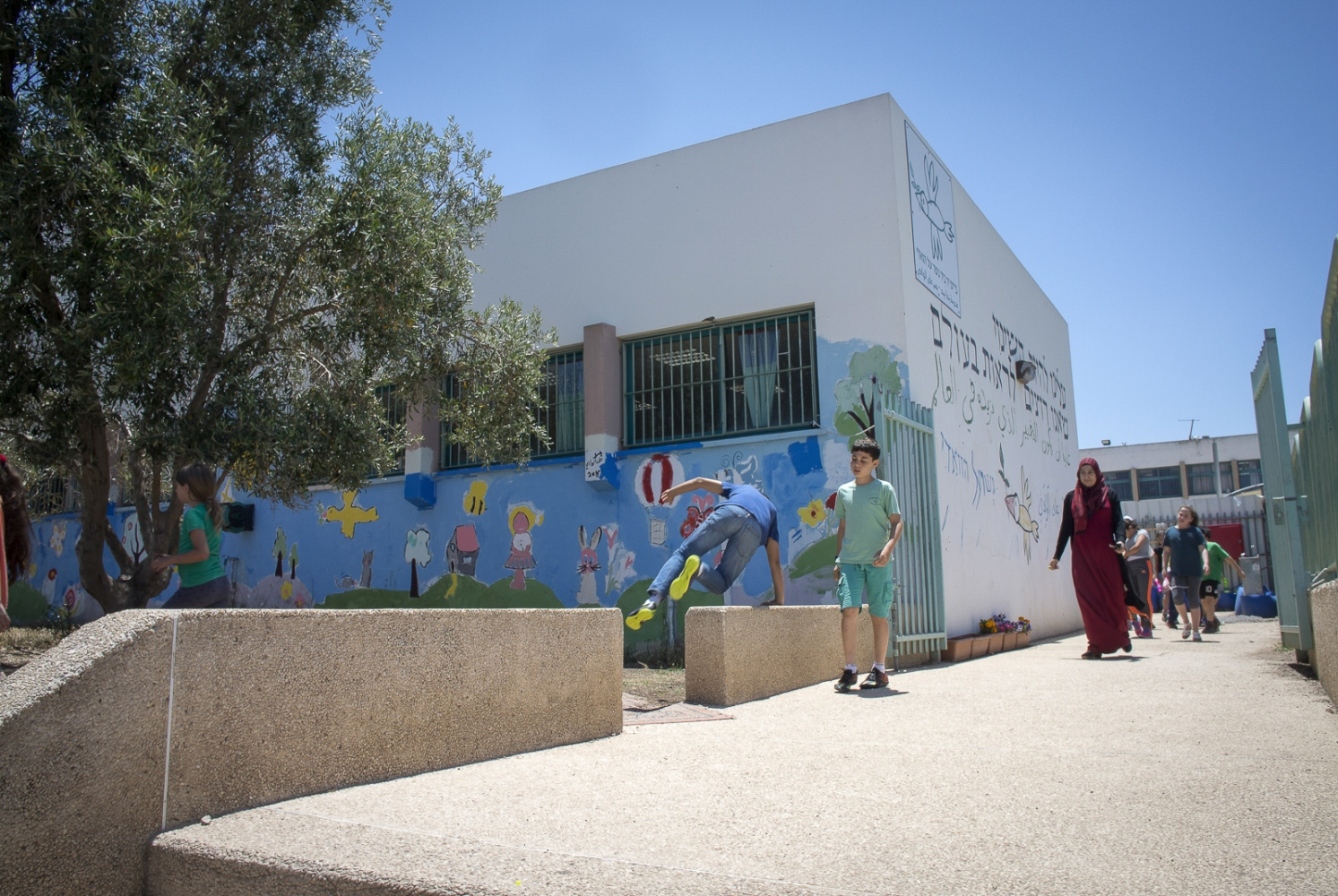 The Wadi Ara Hand in Hand School in Northern Israel. The lettering on the side of the school is in both Hebrew and Arabic it reads: 'We must be the change we want to see.""