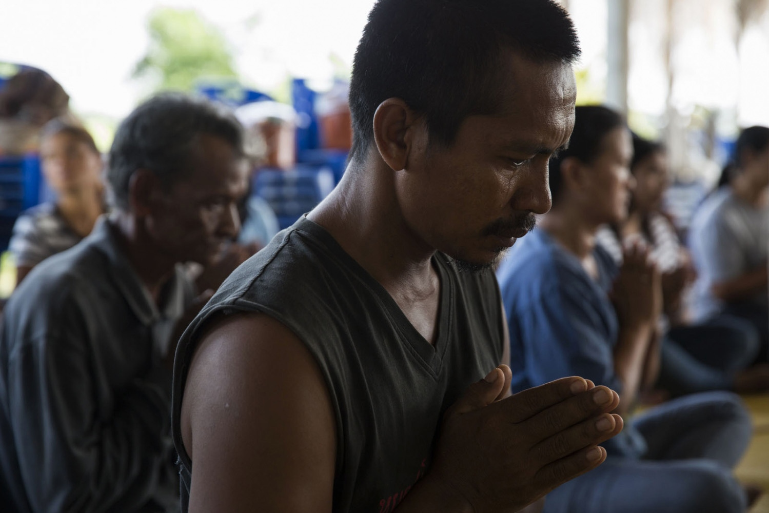 Supot Kalasong, 42, cries during a Buddhist monk ceremony at the village to mark the anniversary of those who had been killed. In April 2016 Mr Kansong himself was shot by an assassin who had been waiting for him to drive past as he returned to the village. He remarkably survived.