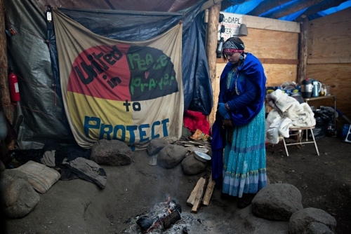 """Julianna """"Jewels"""" Sequoyah, an Eastern Cherokee from Carolina, has been at the Camp """"since the buffalo."""" She volunteers at the Oceti Sakowin Camp providing security at the entrance of the Camp."""