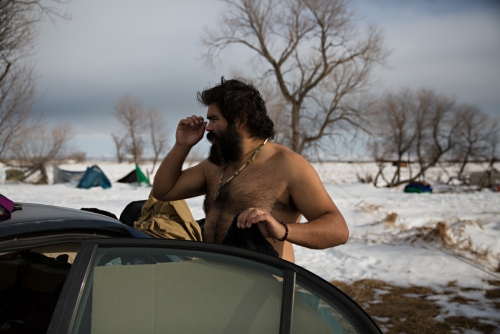 Hunwtokono from San Diego, CA, is at the Camp to make sure the pipeline gets moved away from the river.. He sleeps in his small car even with the snow and the cold North Dakota temperatures.