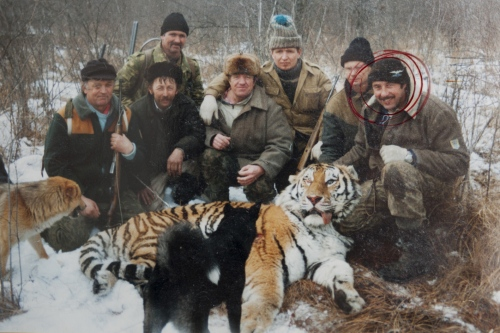 Yuri Trush, leader of the Conflict Tiger Patrol, responsible to relocate or hunt tigers out of control poses with the male responsible of Markov´s death alongside with his crew.