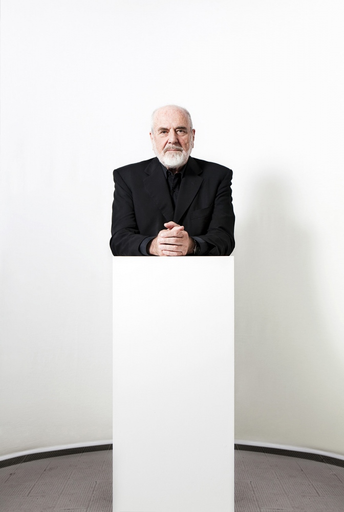 Pistoletto, artist, posing on one of his sculture in his centre of art in Biella, 2011