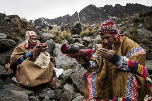Shamans praying in Qollurity