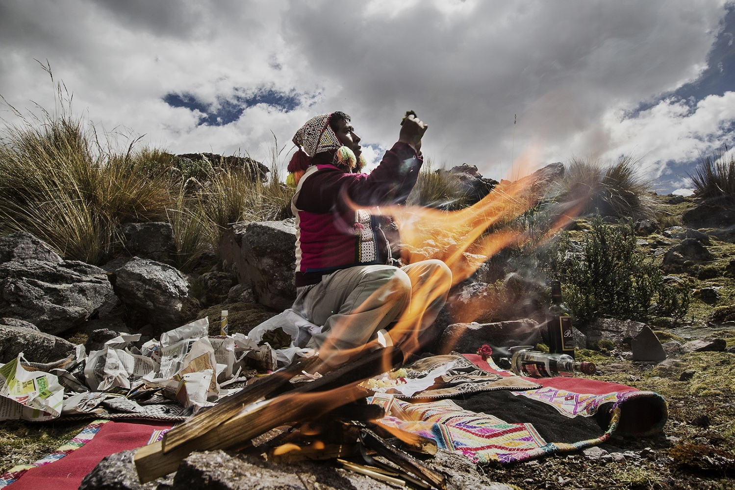 Isidro Callo Huaman is from the Ausangate nation. He lives up to 4600 m. Falling in Ocongate district. He is doing a ritual offer to relate with  Apus (spirits of the sacred mountains) and Pachamama (Mother Earth).