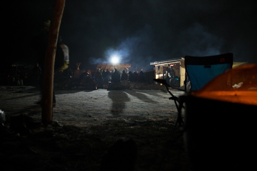 People gathered around the Sacred Fire spend their time in peaceful prayer throughout the night. The Army Corps of Engineers halted the Dakota Access Pipeline by denying the easement sought by the oil company to drill under the Missouri River.