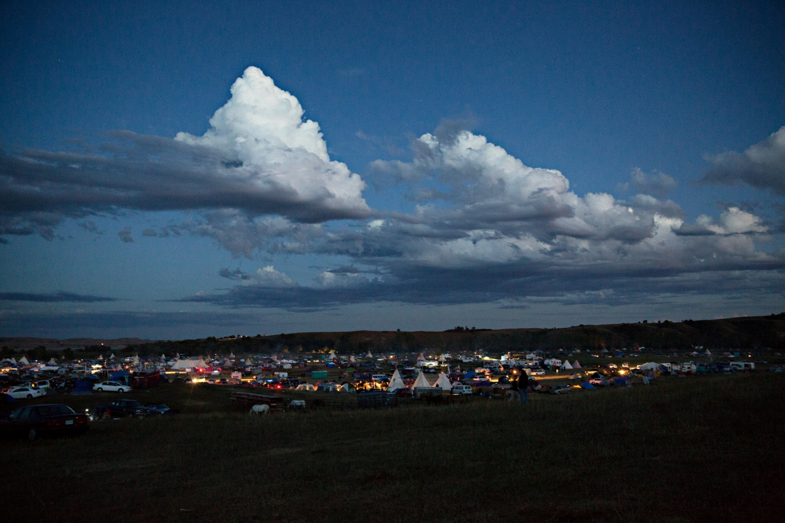 "A view at dusk of the camp from the adjacent hill known  the ""Facebook Hill"" which was one of the few areas where cell phone connection was at its strongest. At times, it was estimated that some 7000 protectors, and supporters occupied the Oceti Sakowin Camp."