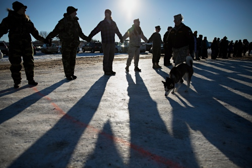 A human chain made out of Veterans and members of the Camp surrounded the Camp shortly before the news came down that the Corps of Engineers had denied the easement to drill under the Missouri River. The Army Corps of Engineers halted the Dakota Access Pipeline by denying the easement sought by the oil company to drill under the Missouri River.