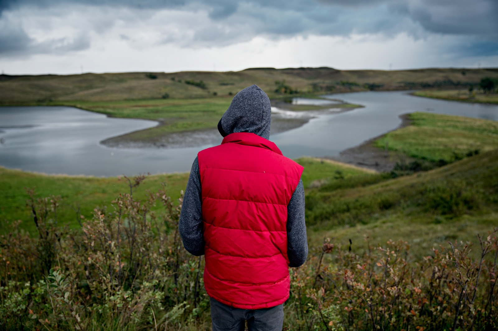 A man looks at the Missouri River where it meets with the Cannonball River. The pipeline threatens the safety of drinking water of the nearby Reservations.