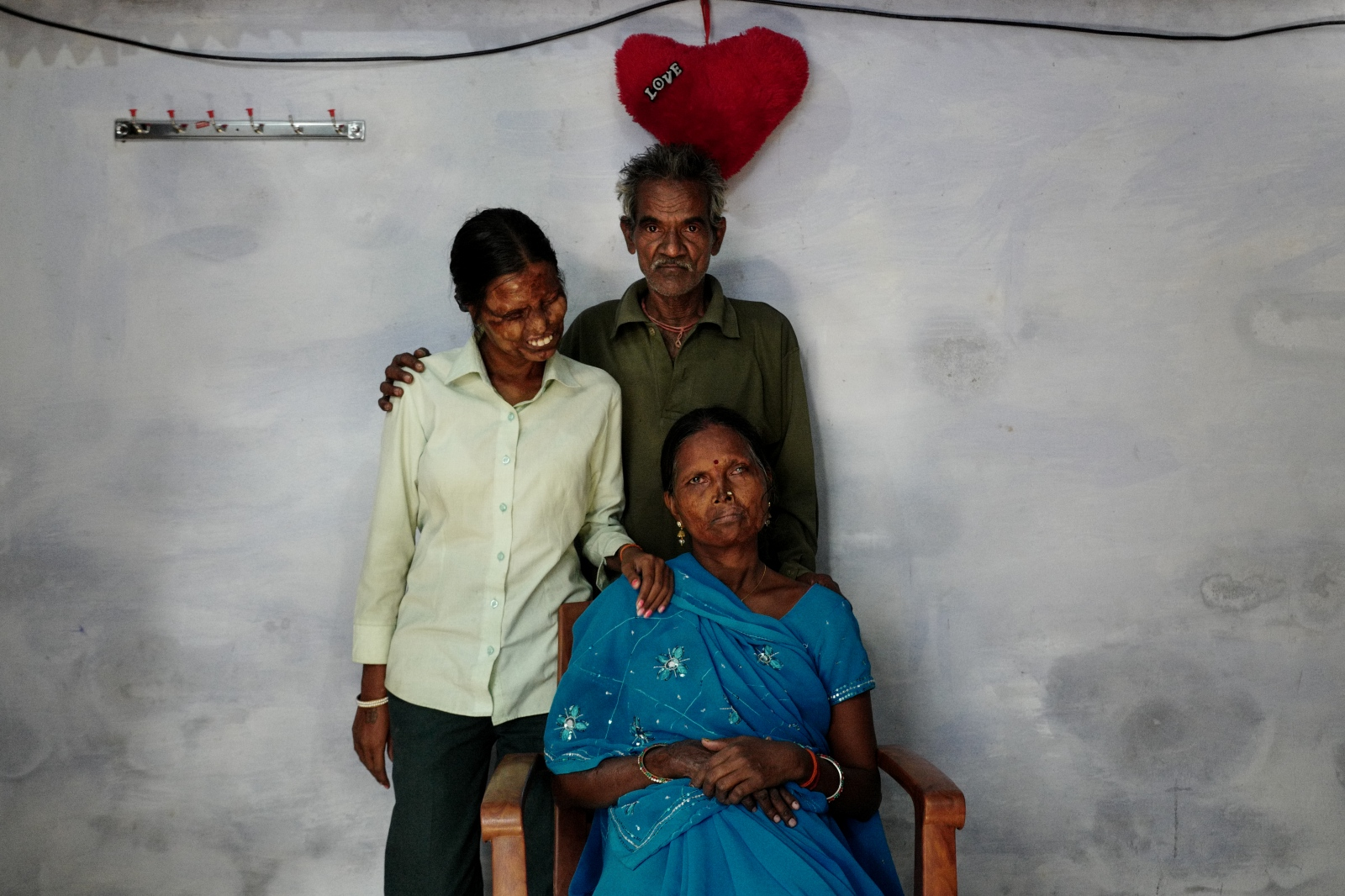 A gra, India. November 11, 2016. Neetu 27, Geeta 50 and Indrageet 50 husband and father who attacked them in 1992, posing for a family portrait in their home in Shahganj, Agra. They continued living together even after the attack followed by Geeta's forgiveness.