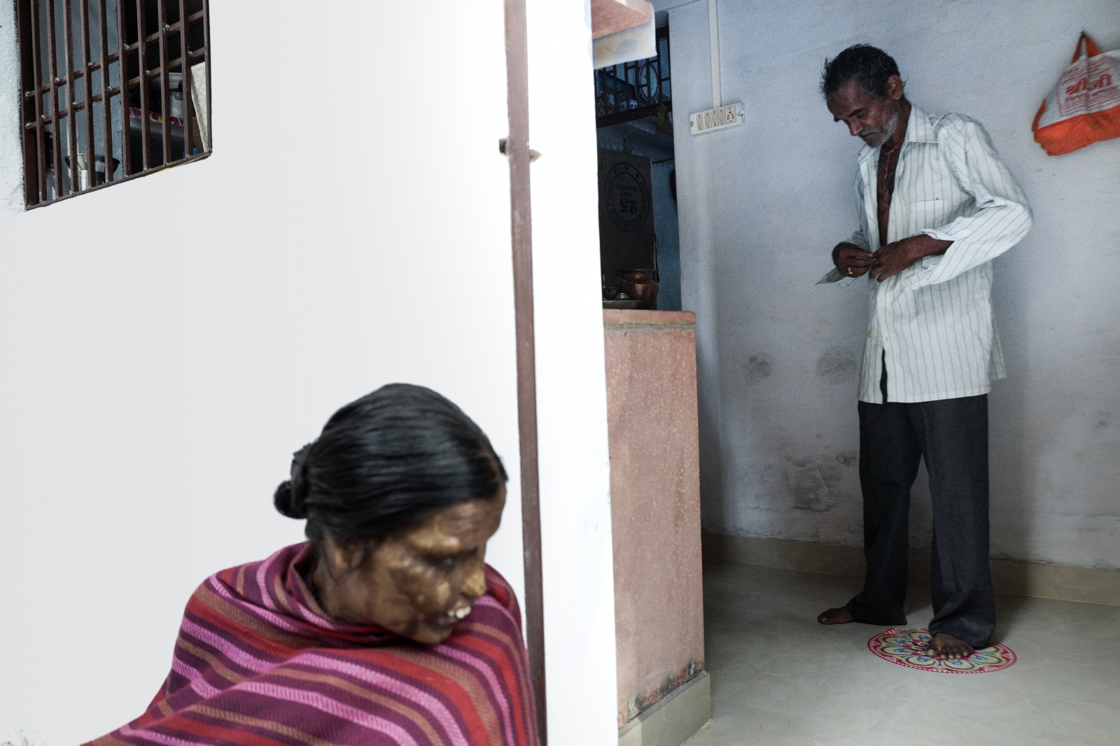 "Agra, India. November 09, 2016. Neetu calls her father ""papa"" while he is getting dressed."