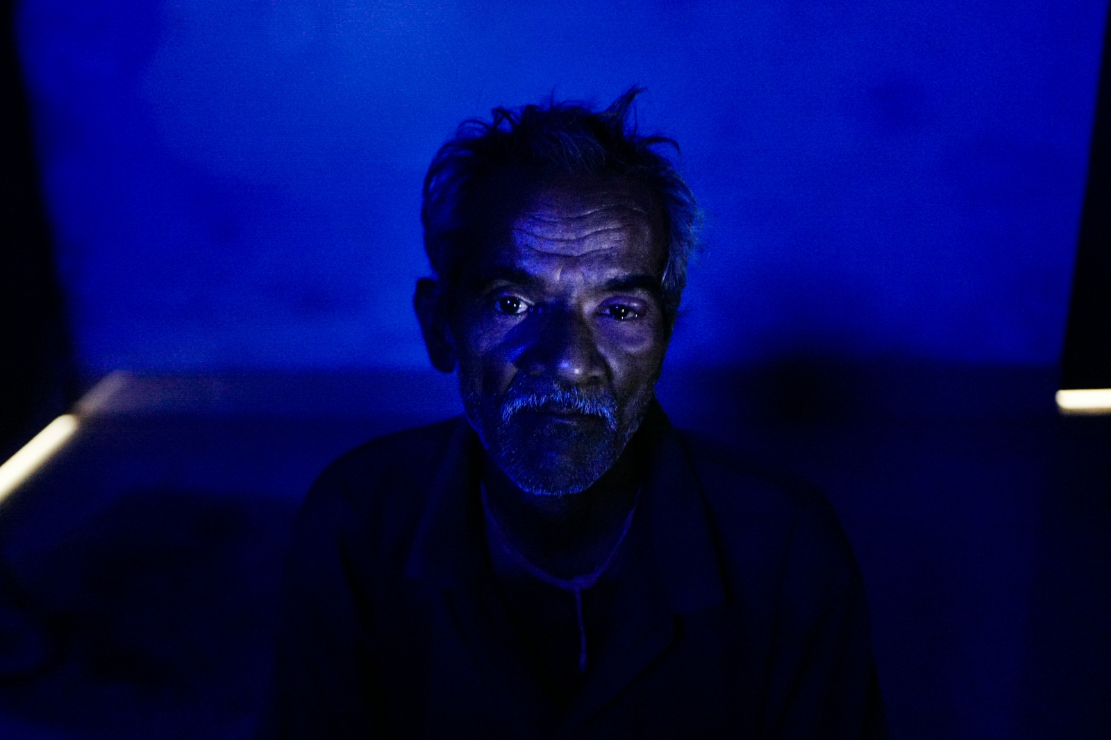 Agra, India. November 13, 2016. Portrait of Inderjeet, 50, the man who attacked his family in 1992. He served only three months in prison. His wife granted him forgiveness after receiving a threatening letter referring to attacks on her parents. She decided to continue living with him to avoid another attack.