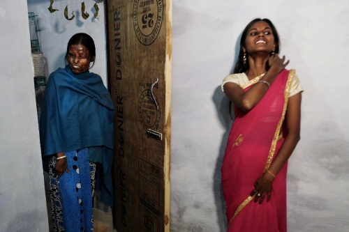 Agra, India. November 11, 2016. Punham smiles wearing a saari. She is getting married in three years. Neetu was married to a man who died only four years after marriage.
