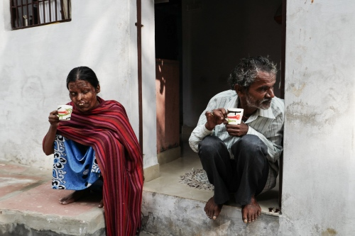 Agra, India. November 09, 2016. Father and daughter having a cup of tea. The reason he attacked Neetu, her mother and her sister was that he wanted a male instead of females. Her sister Krishna didn't make it and died due to the attack.