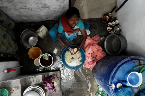 Agra, India. November 011, 2016. Geeta in the small washing space doing the family's laundry.