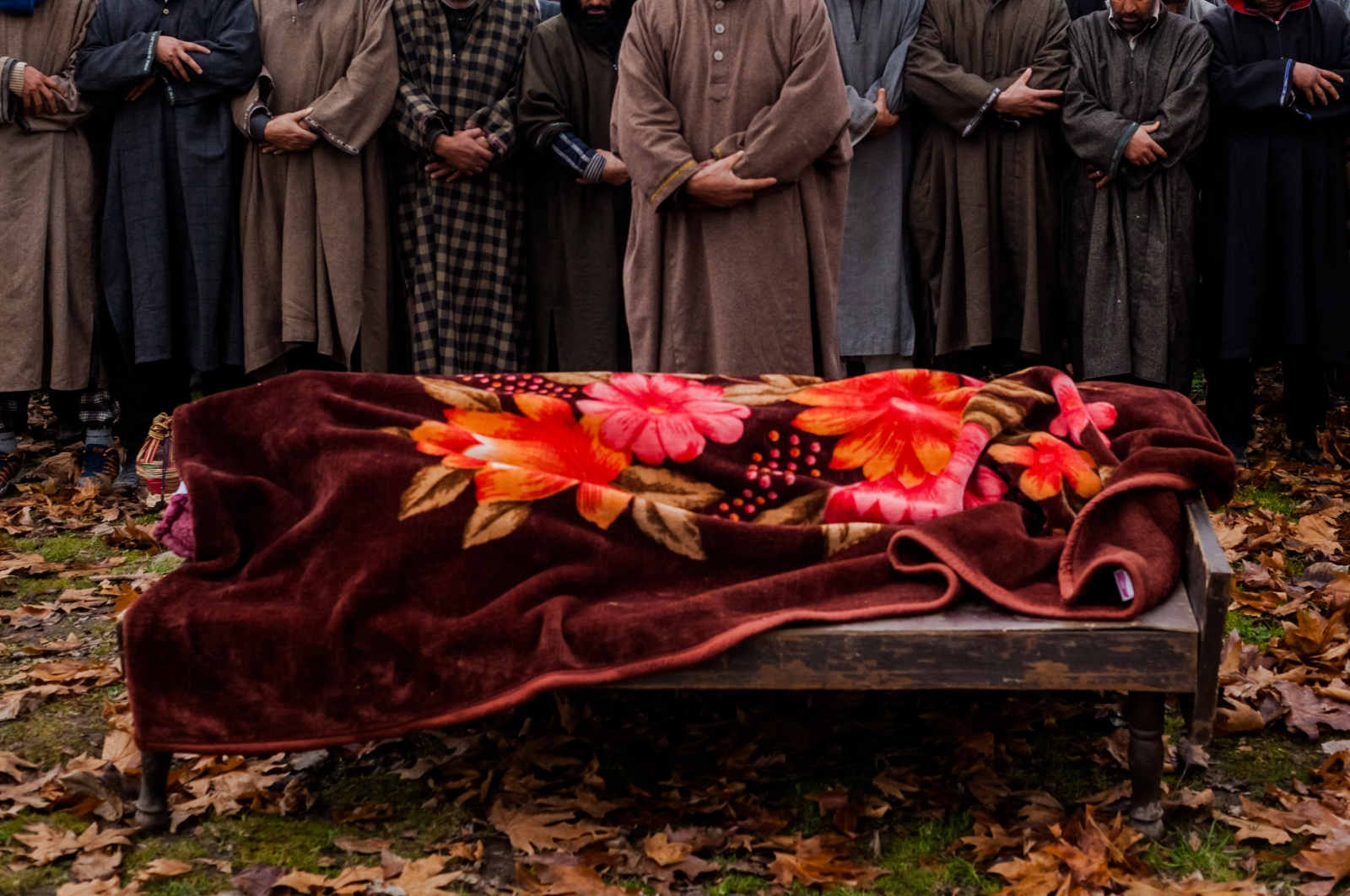 Kashmiri mourners offer prayers during the funeral of Rasiq Ahmed Khan, aged around 22, and who was found shot to death, in Watchohallan village in south Kashmir's Shopian district some 80 kms from Srinagar, on December 14, 2015. Raisq, who disappeared on December 13, was found shot to death by gunmen who local residents report were members of the Indian police Special Operations Group.