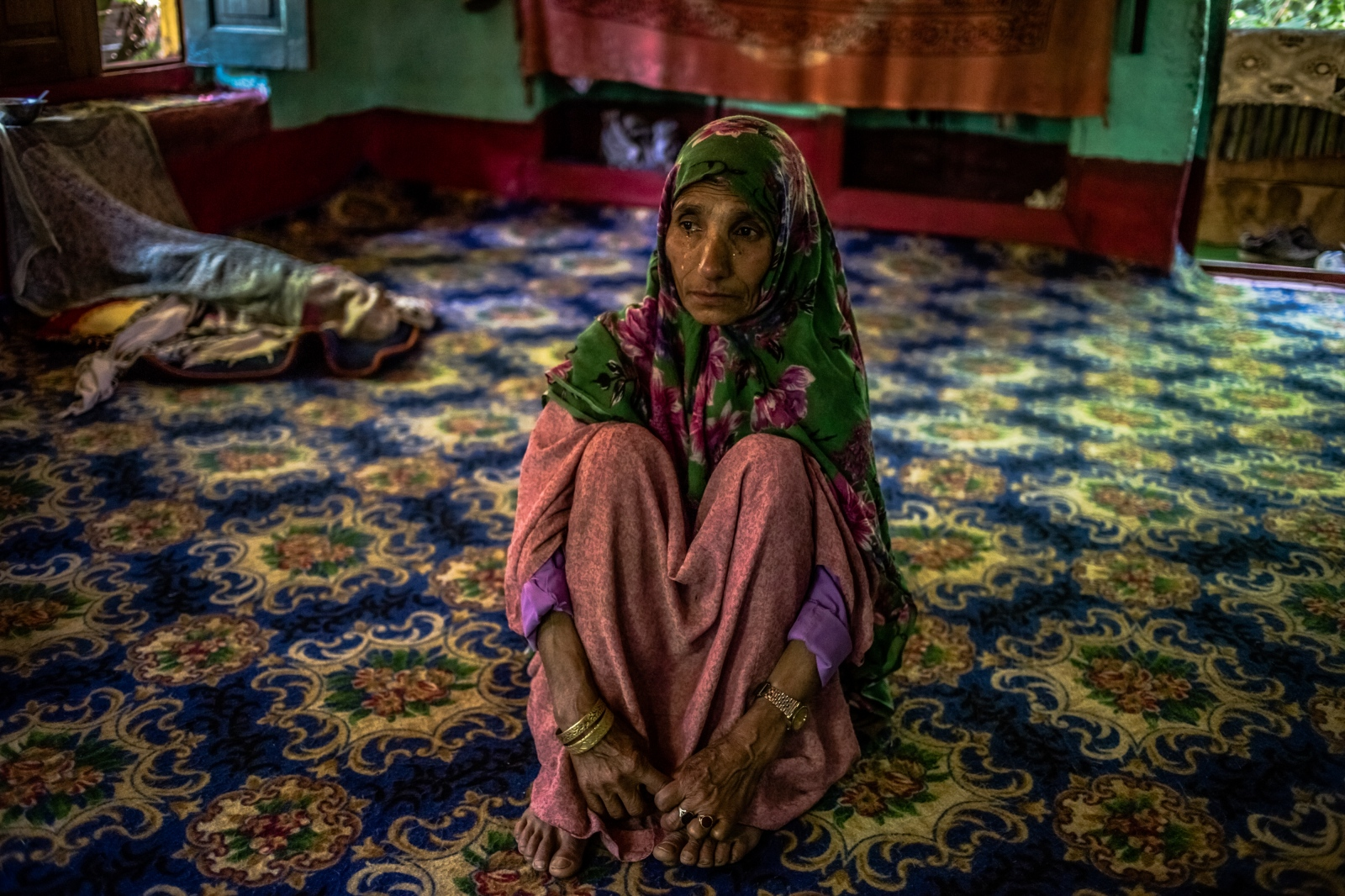 Kashmiri mother Rahma Begum, who is unsure of her age, recounts the disappearance of her son Mir Ali, who went missing in 2003, one year after he married, at her home in Wantwoora Mohalla in Kandi in north Kashmir's Kupwara district on June 29, 2016. For three years after he went missing, Rahma searched for her son, leaving home daily to visit surrounding villages and consult with 'pirs', or faith healers in the district of Sopore and Srinagar who told her they could 'contact' her son. Villagers told her the search was in vain. 'They told me I had gone mad, that I was mad', she says. She finally stopped looking for Ali after seeing her son in a dream.