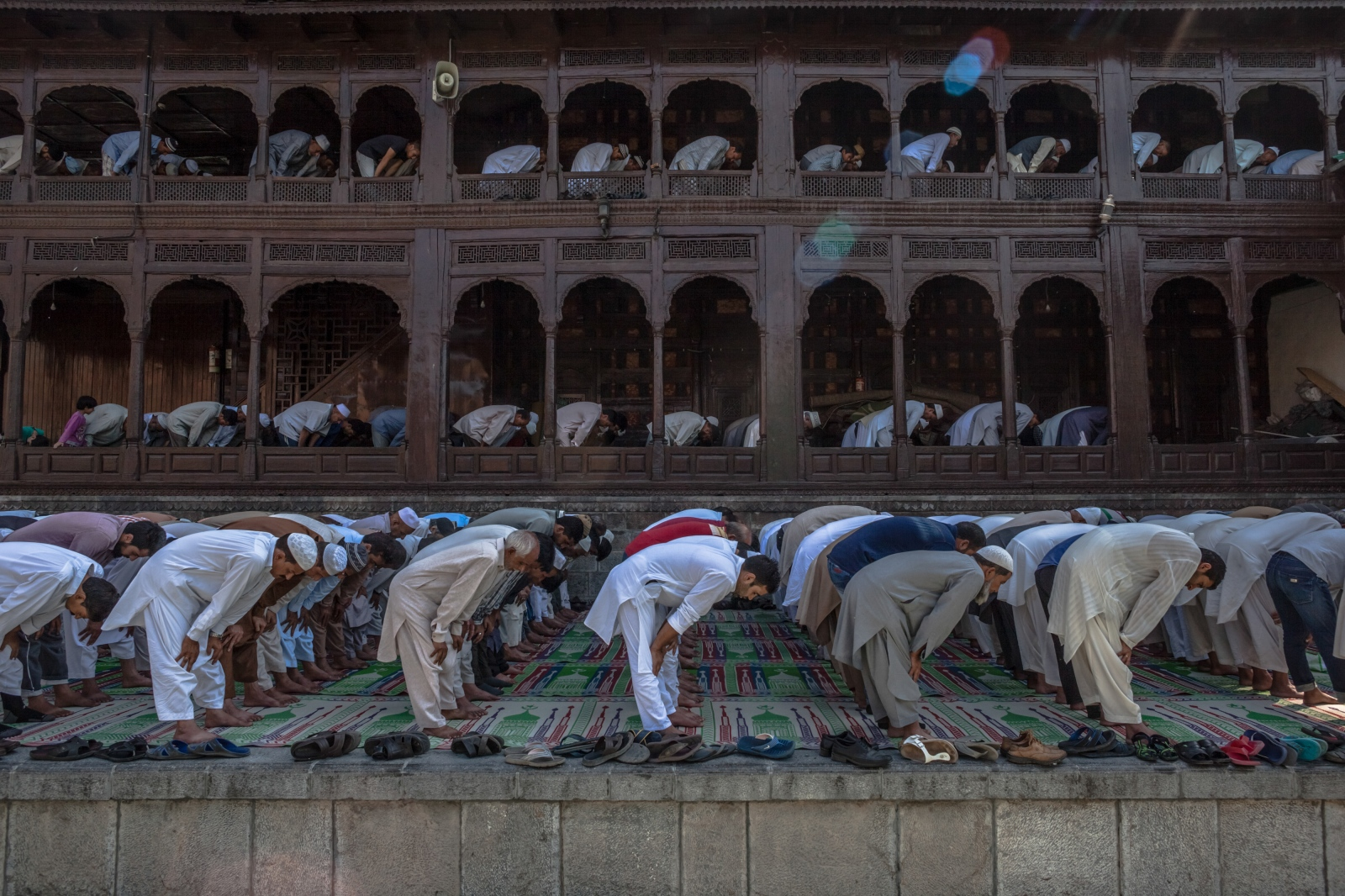 Kashmiri Muslims offer prayers to mark the urs, or death-anniversary, of Sufi scholar Mir Syed Ali Hamden at the Shah-i-Hamdan shrine, amid an ongoing curfew and strike, on the banks of the Jhelum River in Srinagar on September 9, 2016.