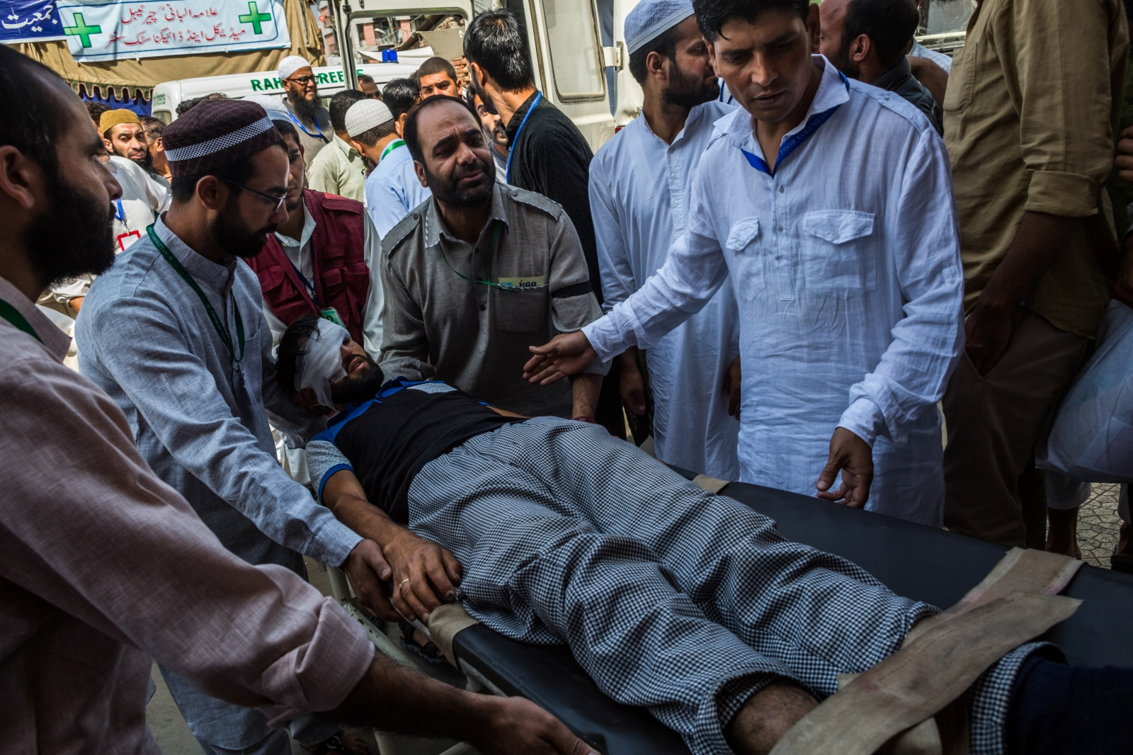Kashmiri hospital volunteers carry a man injured by pellets from an ambulance outside the emergency department at the Shri Maharaja Hari Singh (SMHS) hospital, during a strict curfew on Eid-al-Adha, one of the most important religious festivals in the Muslim calendar, in Srinagar on September 13, 2016.