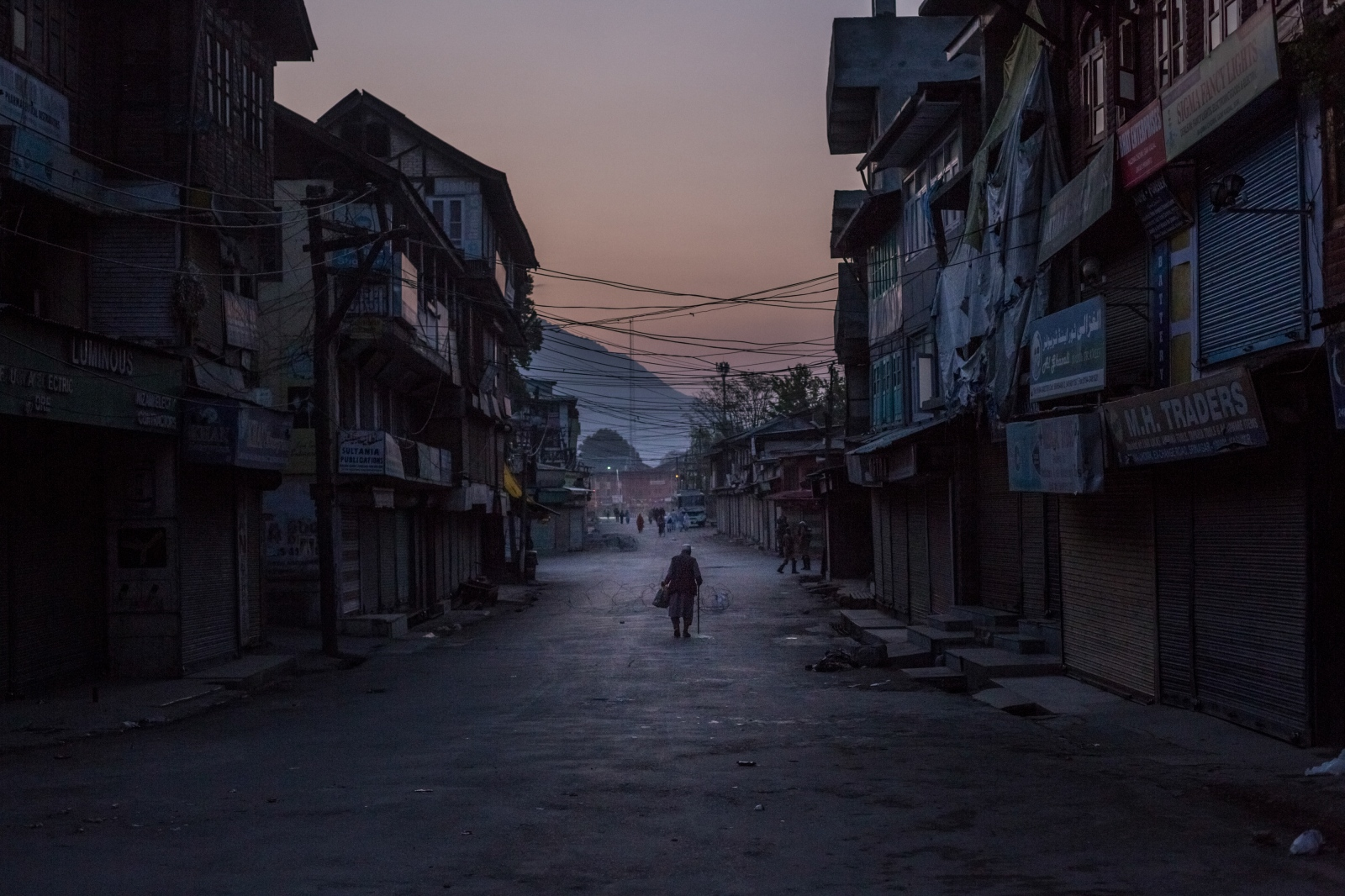 Kashmiri resident walks along a street following morning prayers, and at the start of a day of shutdown and curfew, in the Maisooma area of in Srinagar on October 5, 2016.
