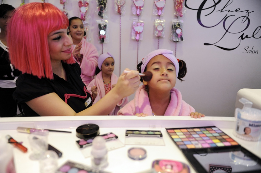 A child take part of a 'make-over' session at a nine-year-old's birthday party held at Frizzy's Chez Lulu's beauty salon.