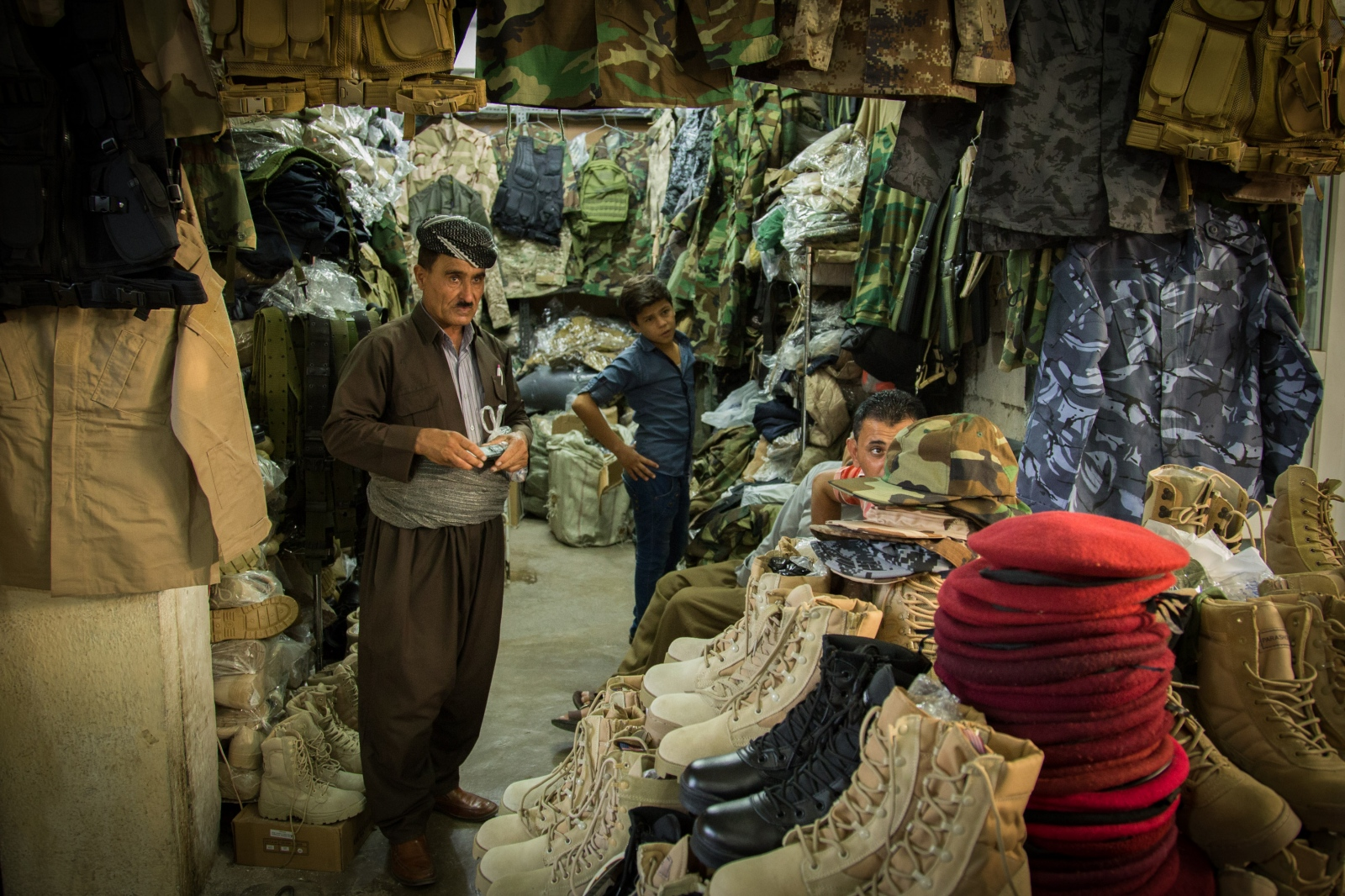 Wartime clothing and equipment for sale at a military market in Erbil, Iraq.