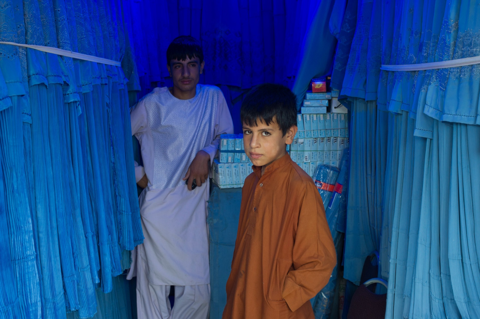 Brothers sell burqas in Herat, Afghanistan.