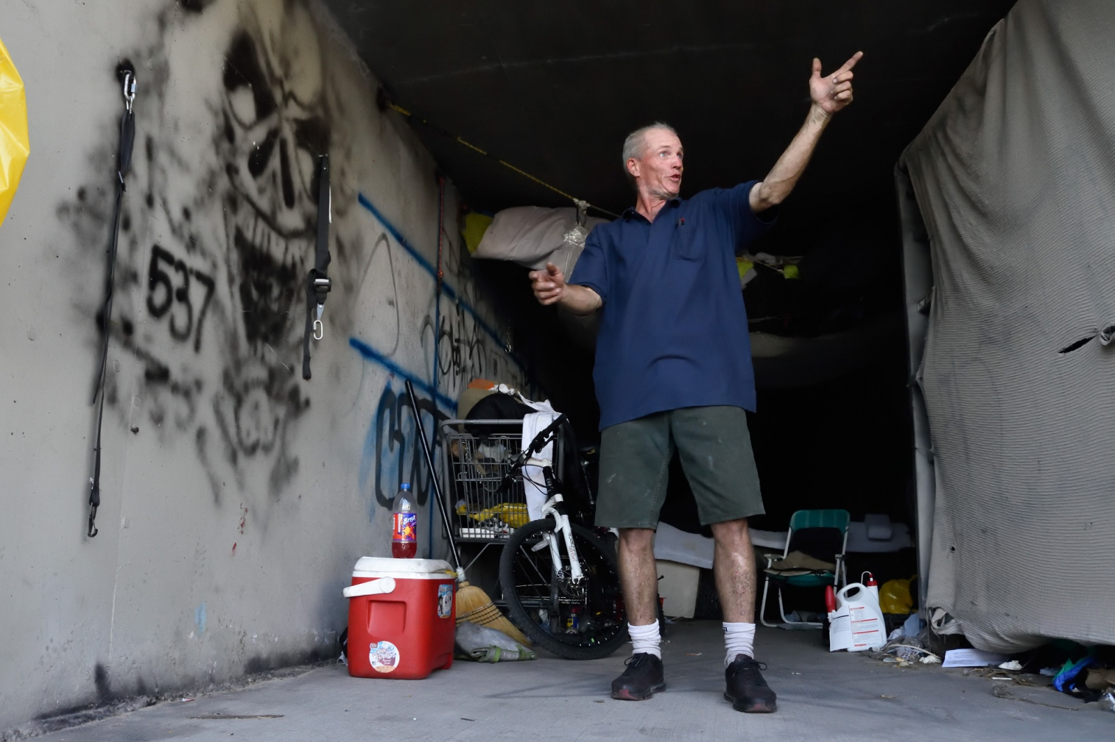 "Bill Is an Army veteran and lives near the entrance of a flood tunnel with one luxury: massive hinged steel doors that can be shut and locked in seconds. ""I know how to watch my front, my back, my left and my right."""