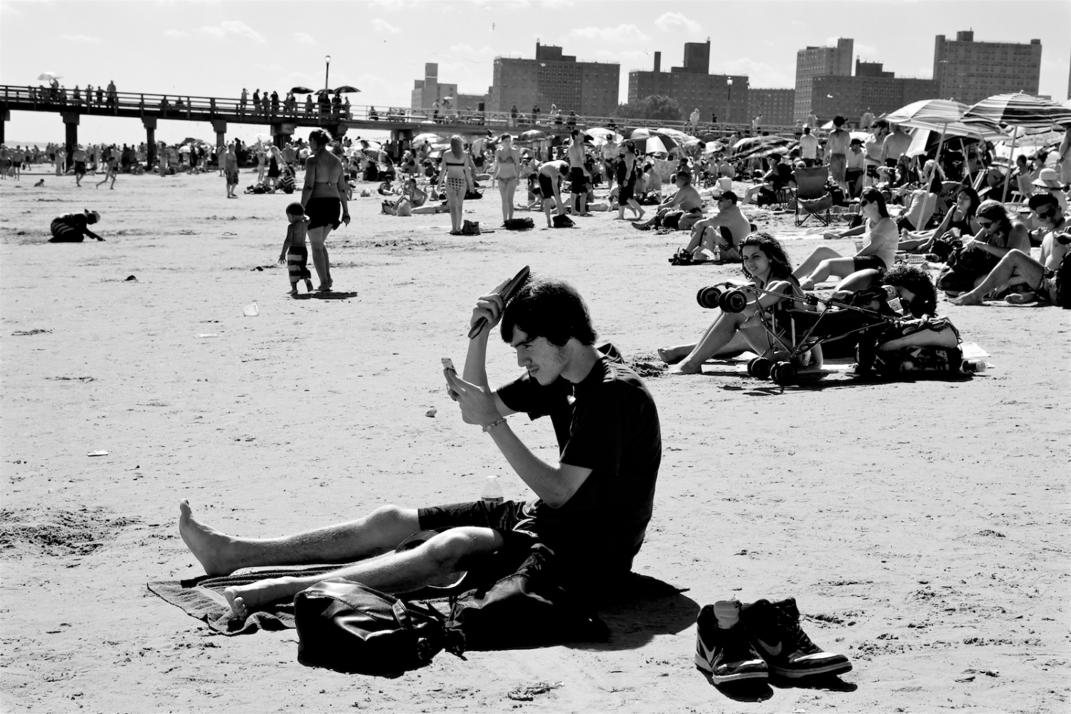 Boy Brushing Hair. Coney Island, NY, Summer 2011