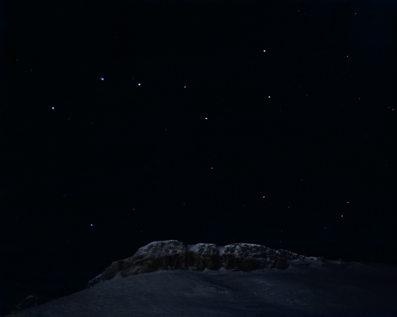 The stars of the dipper hangs over the mountains in Arctic Bay. In the darkest part of the winter, stars can be seen at noon.