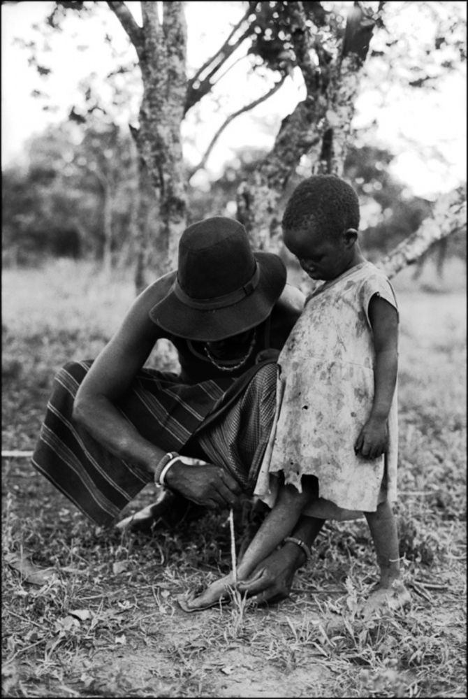 Father Tying Child's Laces, Mugie Ranch, Kenya, August 2002