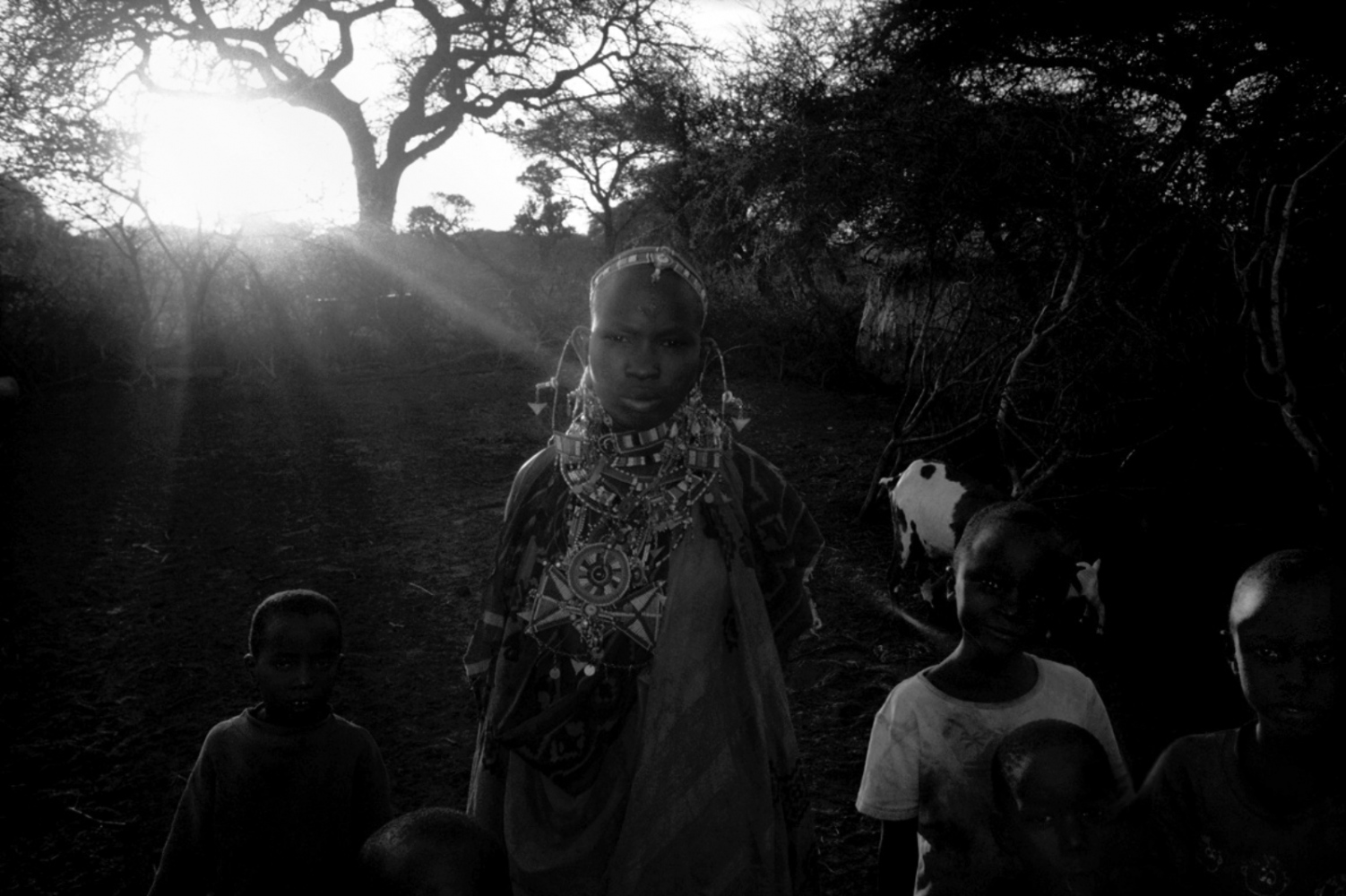 Girl with Necklaces and the Sun, Chyulu Hills, Kenya, August 2002