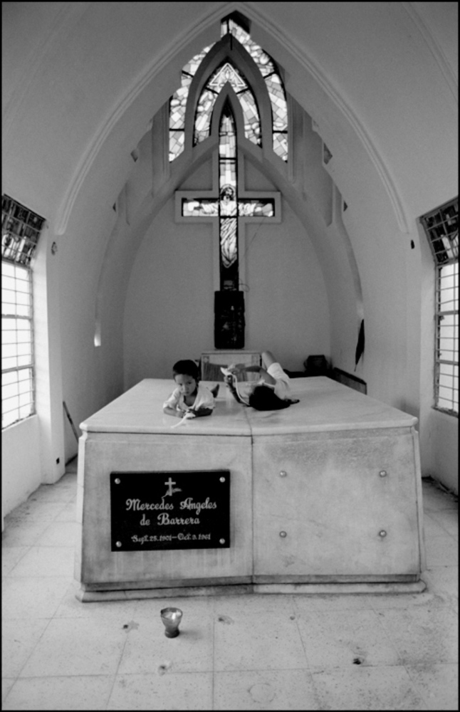 Children Playing inside Mausoleum, North Cemetery, Manila, Philippines, November 2005